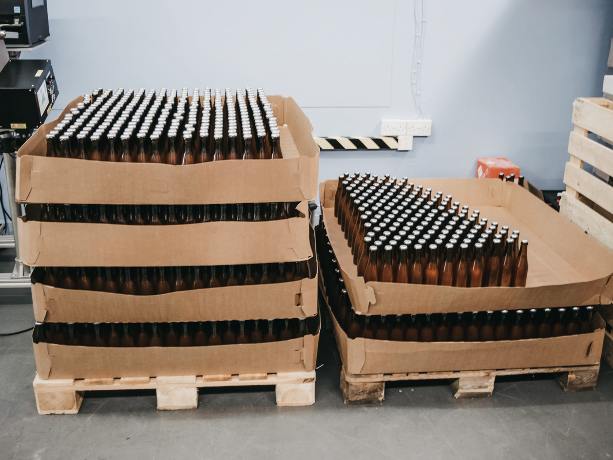 Pallets of Roots Soda bottles.