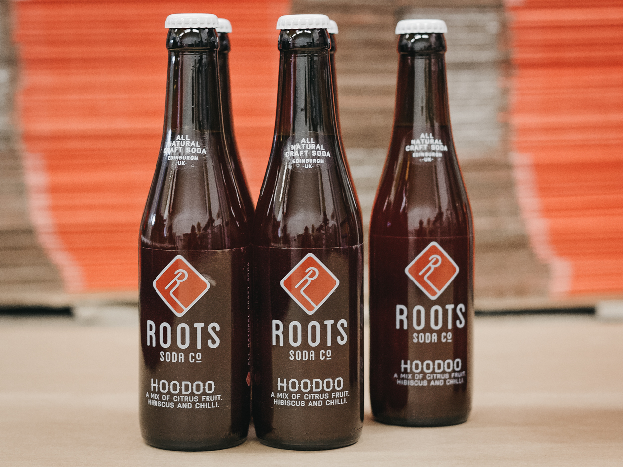 Bottles of Roots Soda co. Hoodoo.