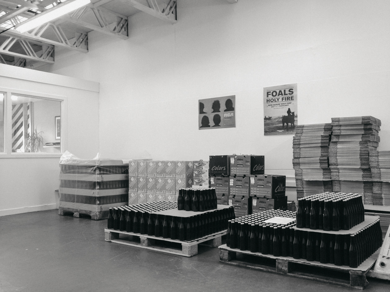 Bottles, boxes, and fruit at Roots HQ.