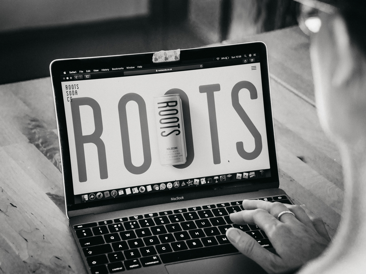 New Roots Soda Co. website on laptop